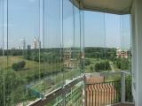Безрамное остекление балкона в многоэтажке