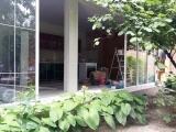 Раздвижная стена с веранды в сад